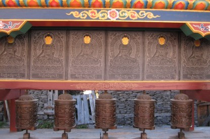 Buddhist prayer wheels at the entrance gate of Manang village.