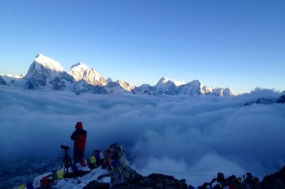 The mountains rises above the cloud, view from Gokyo ri.
