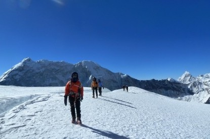 Climbers walking on the snowfield below the steep climbing section of Island peak.