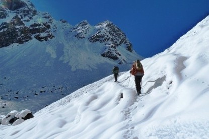 Walking on snowy trail over Nango la pass before Ghunsa.