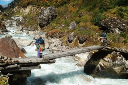 Porters crossing the wooden bridge